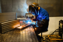 Working Welder Welds Parts Fac...
