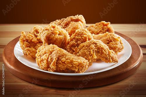 Fototapeta crispy coated batter southern style fried chicken in a wooden table obraz