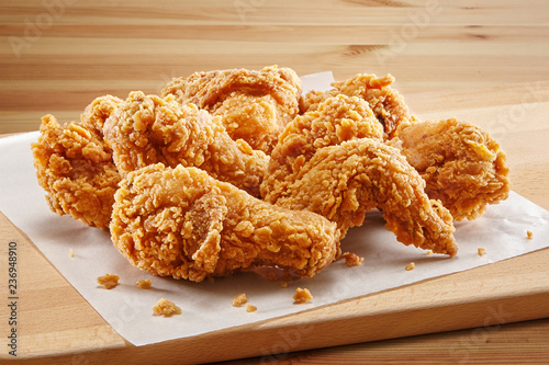 Fototapeta crispy coated batter southern style fried chicken in a wooden table obraz