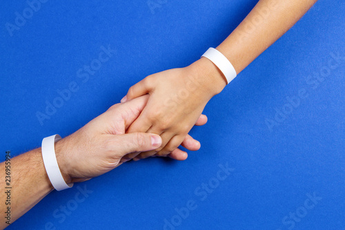Canvas-taulu Mockup template blank paper wristband, bracelet on man and kid arms, blue color