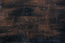 Rough Texture Of A Old Black And Brown Wall.