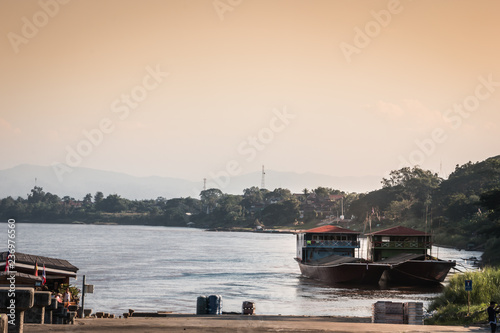 Ferry crossing from Thailand to Laos Wallpaper Mural