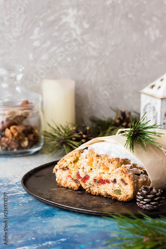 Poster Traditional Christmas stollen with dried fruit and candied fruits