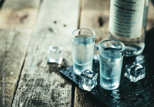 Traditional greek vodka - ouzo in shot glasses Poster Mural XXL