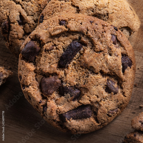 Chocolate chip cookies on wooden table. Top view