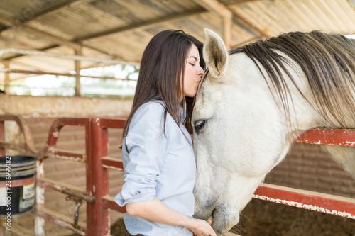 Fototapeta Attractive Woman Giving Her Horse A Kiss obraz