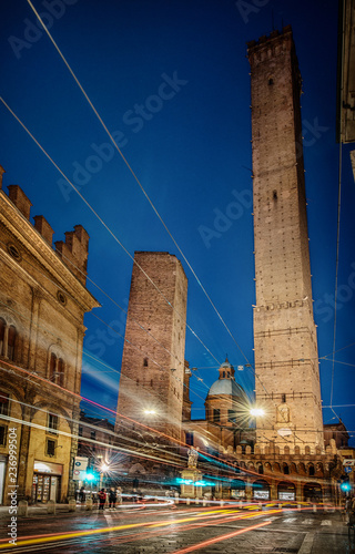 Two famous falling Bologna towers Asinelli and Garisenda. Evening view, long exposure. Bologna, Emilia-Romagna, Italy.