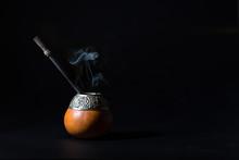 Yerba Hot Tea Mate Drink With Smoke On Black Background
