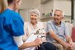 Leinwanddruck Bild - Senior couple consulting nurse