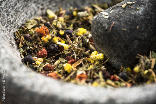 Photo  Mixed dry herbs in mortar or pestle,healthy herbal tea