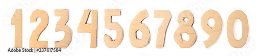 Set of cardboard numerals on white background, top view
