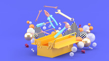 Toolbox Amidst Colorful Balls On A Purple Background.-3d Rendering.