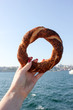 hand holding a turkish simit