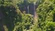 aerial view waterfall coban sewu in Java, indonesia. waterfall in tropical forest by drone Tumpak Sewu aerial footage