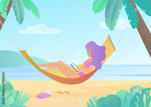Photographie Girl in swimsuit in hammock between palm trees using smartphone and relaxing on beach