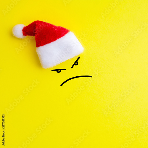 Emotion Of Evil Face Expression And Red Santa Claus Hat On