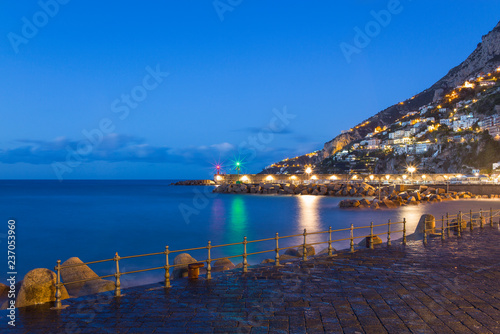 Keuken foto achterwand Poort lights of port lighthouse and coast houses in Amalfi in Italy