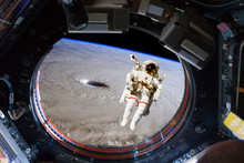 Astronaut Spacewalk Near The Earth. View From The Space Ship Illuminator. Elements Of This Image Furnished By NASA F