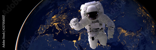 Keuken foto achterwand Nasa astronaut spacewalk at night from the dark side of the earth planet. Elements of this image furnished by NASA d