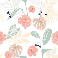 Fototapeta Egzotyczne Tropical plants and pastel hibiscus. Seamless tropical pattern, background. On soft colors background with palm monster leaves, berries and flowers.
