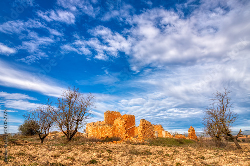 A Landscape Photo Of The Ruins Of An Old Stone Farm House