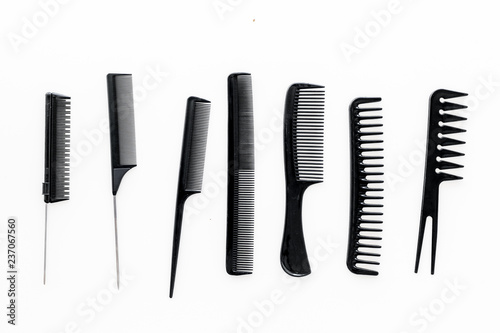 Cuadros en Lienzo female hairdresser desk with accessories and combs on white background top view