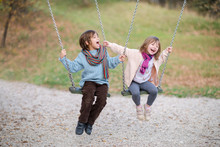 Kids Swing In The Park