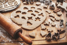 Gingerbread Dough With Metal Cutters For Christmas Cookies On Rustic Table With Wooden Rolling Pin, Cinnamon ,anise, Cones, Christmas Decorations. Atmospheric Stylish Image