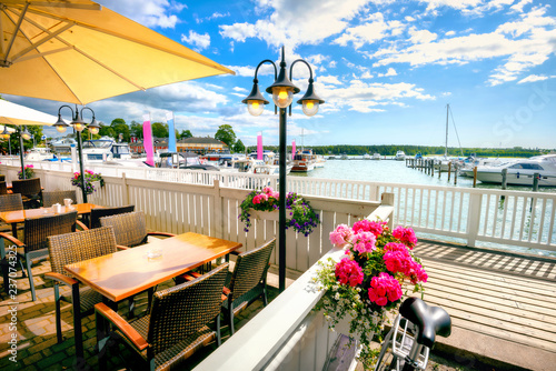 Montage in der Fensternische Skandinavien Seafront with cafe and marina in Naantali town at sunny summer day. Finland