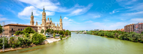 River Ebro and Our Lady El Pillar basilica in Zaragoza, Spain .