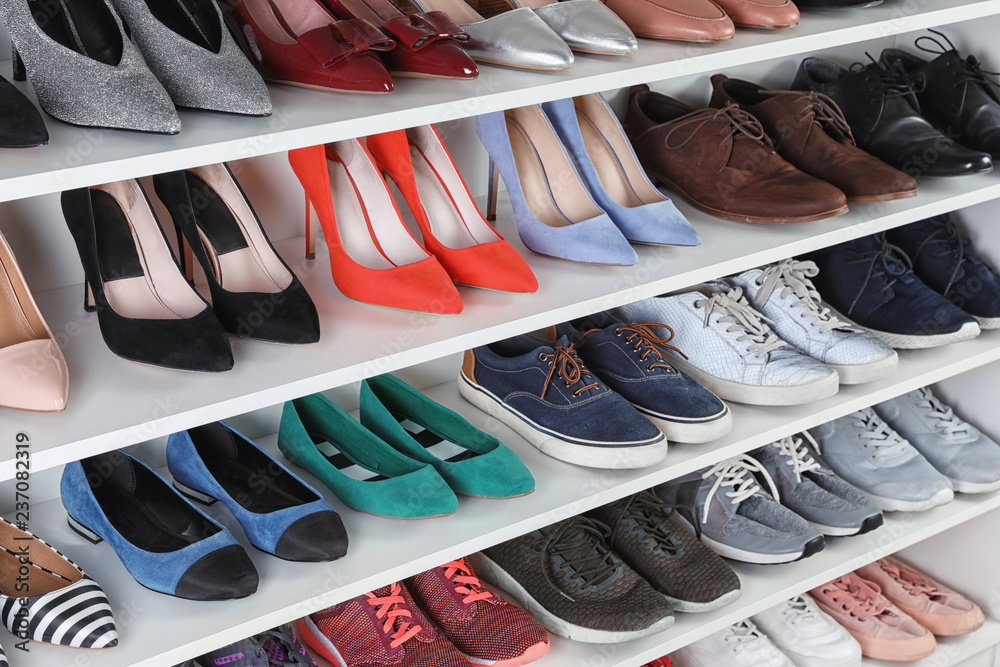 Fototapety, obrazy: Shelving unit with different shoes. Element of dressing room interior