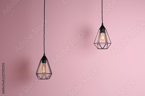 Cuadros en Lienzo Modern hanging lamp on color background. Idea for interior design