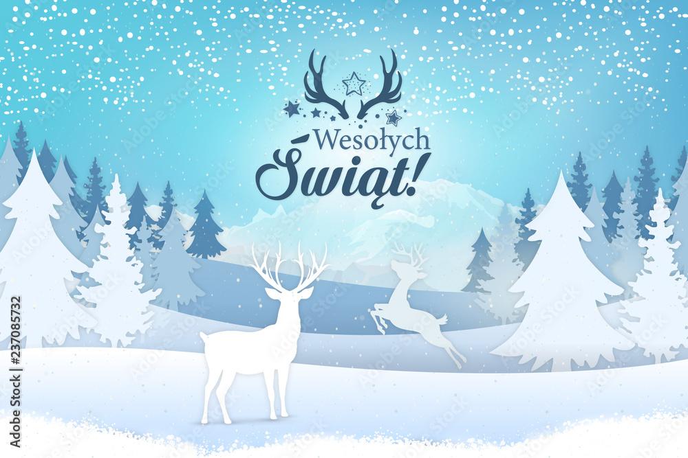 Fototapeta Koncepcja kartki z życzeniami świątecznymi Wesołych Świąt napisane po polsku. Stylowy napis z motywem świątecznym, na tle zimowego widoku na jelenie, drzewa i góry z padającym śniegiem