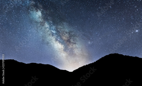 Fototapeta Night landscape with colorful Milky Way over Mountains obraz na płótnie