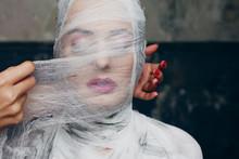 Glamorous Mummy.Beautiful Glamorous Woman With Makeup, Fully Bandaged, Wrapped In Bandages Face
