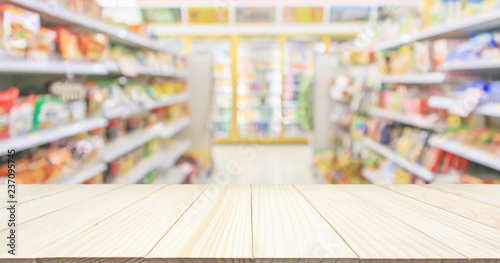 Fototapeta  Wood table top with Supermarket convenience store aisle shelves interior blur fo