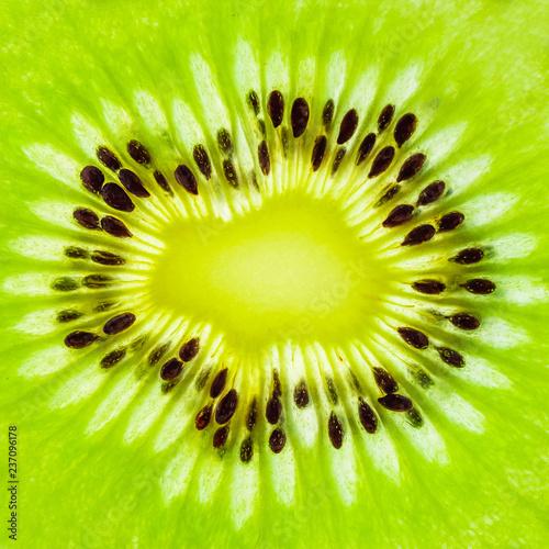 Spoed Foto op Canvas Plakjes fruit Fresh kiwi fruit slices closeup macro texture background