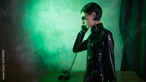 Young woman in matrix style suit, digital Internet technology and telecommunicat Canvas Print