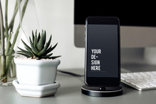Mockup Of A Mobile Phone On A Stand
