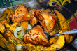 Homemade Chicken thighs and pumpkin pieces baked in glass form. Cooked food. Selective focus.