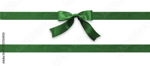 Obraz Green bow ribbon band satin emerald stripe fabric (isolated on white background with clipping path) for Christmas holiday gift box, greeting card banner, present wrap design decoration ornament - fototapety do salonu