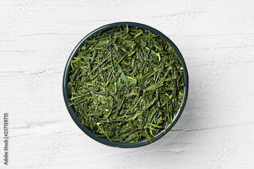 Sencha green tea on white wooden background