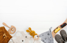 Baby Clothes And Wooden Toys O...