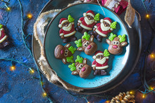 Santa Claus And Chocolate Reindeer With Christmas Lights.