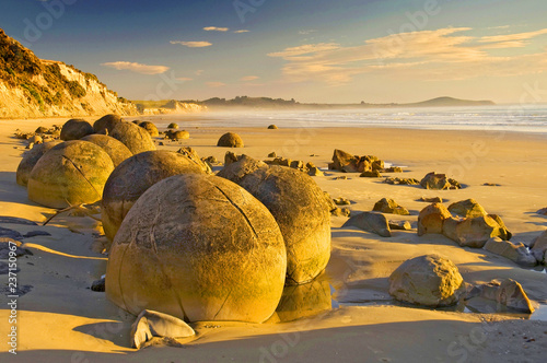 The Moeraki Boulders are unusually large and spherical boulders lying along a stretch of Koekohe Beach on the wave cut Otago coast of New Zealand between Moeraki and Hampden Canvas Print
