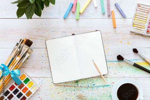 Fotografie, Obraz  Colorful creative table with blank notebook for sketches and paints, pencil, pai
