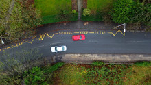 Aerial View Of A School Keep Clear Road Sign In The UK