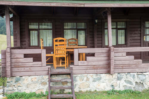 Photo  The Veranda of a Wooden House