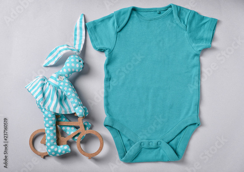 d5bbc620c92e Baby clothes and toy on white background
