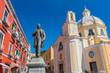 Antonio Scialoja statue on Terra Murata quarter and Santa Maria delle Grazie church, Marina di Corricella, Procida, Gulf of Naples, Campania, Italy.